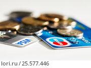 Купить «Кредитки и металлические рубли на светлом фоне», эксклюзивное фото № 25577446, снято 6 февраля 2017 г. (c) Игорь Низов / Фотобанк Лори