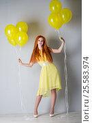 Купить «Young woman with balloons», фото № 25583974, снято 16 февраля 2017 г. (c) Типляшина Евгения / Фотобанк Лори