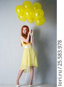 Купить «Young woman with balloons», фото № 25583978, снято 16 февраля 2017 г. (c) Типляшина Евгения / Фотобанк Лори