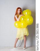 Купить «Young woman with balloons», фото № 25583986, снято 16 февраля 2017 г. (c) Типляшина Евгения / Фотобанк Лори