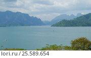 Купить «Cheow Lan Lake, Khao Sok National Park in Thailand», видеоролик № 25589654, снято 4 февраля 2017 г. (c) Михаил Коханчиков / Фотобанк Лори