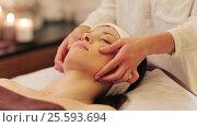 Купить «woman having face and head massage at spa», видеоролик № 25593694, снято 28 января 2017 г. (c) Syda Productions / Фотобанк Лори