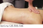 Купить «woman lying and having back massage at spa», видеоролик № 25593726, снято 28 января 2017 г. (c) Syda Productions / Фотобанк Лори