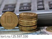 Купить «Монеты десять рублей на фоне калькулятора», эксклюзивное фото № 25597330, снято 22 февраля 2017 г. (c) Яна Королёва / Фотобанк Лори