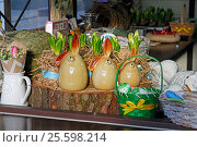"Moscow, Russia - April 21, 2016: Statues of Easter Bunny for sale at the festival ""Moscow spring"" in Moscow. Редакционное фото, фотограф Юлия Олейник / Фотобанк Лори"