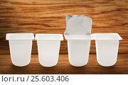 Купить «Empty crushed plastic yogurt pots», фото № 25603406, снято 26 апреля 2016 г. (c) Ярочкин Сергей / Фотобанк Лори