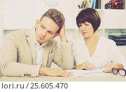 Купить «Man and mature woman sit at table», фото № 25605470, снято 23 марта 2019 г. (c) Яков Филимонов / Фотобанк Лори