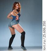 Купить «twerk redhead woman in jeans shorts», фото № 25606350, снято 2 февраля 2017 г. (c) Анатолий Типляшин / Фотобанк Лори