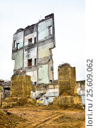 Pieces of Metal and Stone are Crumbling from Demolished Building. Стоковое фото, фотограф Олеся Новицкая / Фотобанк Лори