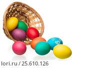 Купить «wicker basket and strewn eggs on a white background», фото № 25610126, снято 8 мая 2016 г. (c) Константин Лабунский / Фотобанк Лори