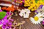 Капсулы в открытой коричневой баночке на доске, фото № 25614870, снято 14 июля 2015 г. (c) Резеда Костылева / Фотобанк Лори