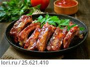 Купить «Grilled sliced pork ribs», фото № 25621410, снято 5 ноября 2015 г. (c) Надежда Нестерова / Фотобанк Лори