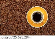 Americano yellow cup and saucer on coffee beans. Стоковое фото, фотограф Anton Eine / Фотобанк Лори