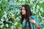 Красивая азиатская девушка с тату хной рядом с цветущей яблоней, фото № 25629602, снято 7 мая 2016 г. (c) 1Andrey Милкин / Фотобанк Лори