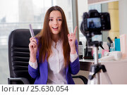 Купить «Beauty fashion blogger recording video», фото № 25630054, снято 10 января 2017 г. (c) Elnur / Фотобанк Лори