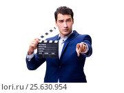 Купить «Handsome man with movie clapper isolated on white», фото № 25630954, снято 5 ноября 2016 г. (c) Elnur / Фотобанк Лори
