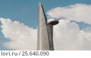 Купить «Bitexco Financial Tower in Saigon Ho Chi Minh City Vietnam in the blue sky», видеоролик № 25640090, снято 1 марта 2017 г. (c) Mikhail Davidovich / Фотобанк Лори