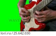 Купить «Mid section of male musician playing guitar», видеоролик № 25642030, снято 15 сентября 2019 г. (c) Wavebreak Media / Фотобанк Лори