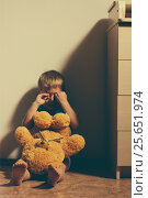 Купить «Scared boy crying in corner with toy bear», фото № 25651974, снято 27 июня 2019 г. (c) Pavel Biryukov / Фотобанк Лори