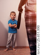 Купить «Mother holding belt to punish little son», фото № 25651990, снято 18 апреля 2019 г. (c) Pavel Biryukov / Фотобанк Лори