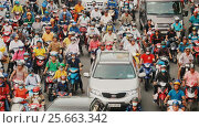 Купить «HO CHI MINH, VIETNAM - OCTOBER 13, 2016: Peak hour. Dense traffic in Ho Chi Minh City. Vietnam.», видеоролик № 25663342, снято 13 октября 2016 г. (c) Mikhail Davidovich / Фотобанк Лори