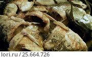 Купить «Cooking on the open fire. Pieces of freshwater fish fried in a cast-iron skillet. HD», видеоролик № 25664726, снято 27 февраля 2017 г. (c) ActionStore / Фотобанк Лори