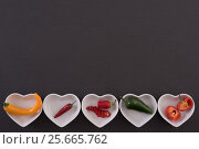 Different chili peppers. Стоковое фото, фотограф Юлия Младич / Фотобанк Лори