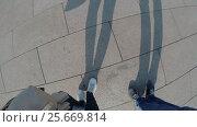 Купить «Couple walking legs and shadows», видеоролик № 25669814, снято 11 января 2017 г. (c) Алексей Макаров / Фотобанк Лори