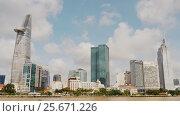 Купить «Skyscrapers business center in Ho Chi Minh City on Vietnam Saigon on background blue sky», видеоролик № 25671226, снято 6 марта 2017 г. (c) Mikhail Davidovich / Фотобанк Лори