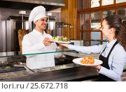 Young waitress receiving order from chef. Стоковое фото, фотограф Яков Филимонов / Фотобанк Лори