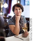 Купить «Elderly lonely woman at dinner in restaurant», фото № 25701670, снято 7 декабря 2019 г. (c) Яков Филимонов / Фотобанк Лори