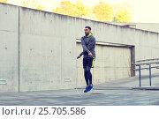 Купить «man exercising with jump-rope outdoors», фото № 25705586, снято 17 октября 2015 г. (c) Syda Productions / Фотобанк Лори
