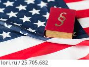 Купить «close up of american flag and lawbook», фото № 25705682, снято 30 июня 2016 г. (c) Syda Productions / Фотобанк Лори