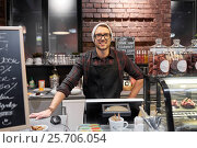 Купить «happy seller man or barman at cafe counter», фото № 25706054, снято 17 ноября 2016 г. (c) Syda Productions / Фотобанк Лори