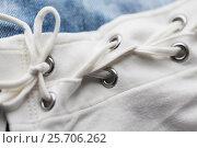 Купить «close up of lacing on clothing item», фото № 25706262, снято 15 сентября 2016 г. (c) Syda Productions / Фотобанк Лори