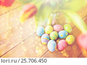 Купить «close up of easter eggs and flowers in bucket», фото № 25706450, снято 28 января 2016 г. (c) Syda Productions / Фотобанк Лори