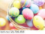 Купить «close up of colored easter eggs in basket», фото № 25706454, снято 28 января 2016 г. (c) Syda Productions / Фотобанк Лори
