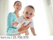 Купить «happy young mother with little baby at home», фото № 25706970, снято 12 июля 2016 г. (c) Syda Productions / Фотобанк Лори