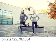 Купить «couple doing lunge exercise on city street», фото № 25707354, снято 17 октября 2015 г. (c) Syda Productions / Фотобанк Лори