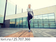 Купить «woman making step exercise on city street bench», фото № 25707366, снято 17 октября 2015 г. (c) Syda Productions / Фотобанк Лори