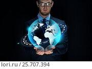Купить «businessman with virtual earth projection», фото № 25707394, снято 6 сентября 2016 г. (c) Syda Productions / Фотобанк Лори