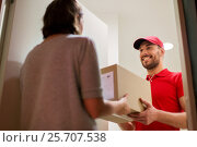 Купить «happy delivery man giving parcel box to customer», фото № 25707538, снято 3 декабря 2016 г. (c) Syda Productions / Фотобанк Лори