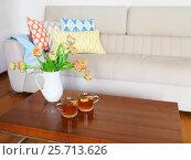 Купить «Beautiful orange tulips bouquet on wooden table in the living room», фото № 25713626, снято 9 марта 2016 г. (c) Дарья Петренко / Фотобанк Лори