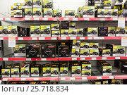 Купить «Стеллажи с аккумуляторами для мотоциклов. Магазин автотоваров Motonet в Финляндии», фото № 25718834, снято 18 февраля 2017 г. (c) Кекяляйнен Андрей / Фотобанк Лори