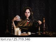 Купить «Young woman with divination cards in room», фото № 25719346, снято 5 марта 2017 г. (c) Майя Крученкова / Фотобанк Лори
