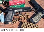 Купить «Пистолеты и патроны к ним», фото № 25737418, снято 20 февраля 2020 г. (c) Михаил Михин / Фотобанк Лори