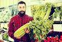 Adult male seller offering celery in shop, фото № 25738694, снято 15 ноября 2016 г. (c) Яков Филимонов / Фотобанк Лори
