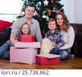 Купить «Young family members presenting gifts on Christmas», фото № 25738862, снято 23 января 2019 г. (c) Яков Филимонов / Фотобанк Лори