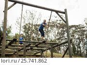 Купить «Fit woman holding the rope during obstacle course», фото № 25741862, снято 24 ноября 2016 г. (c) Wavebreak Media / Фотобанк Лори