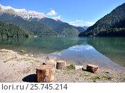 Купить «View of the mountain lake Rizza, Abkhazia», фото № 25745214, снято 26 сентября 2014 г. (c) Александр Карпенко / Фотобанк Лори